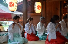 Villagers play traditional Shinto music throughout the evening